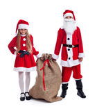 Santa and helper with a large bag of presents Royalty Free Stock Photos