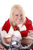 Santa Helper Leaning On Motorcycle Royalty Free Stock Photo