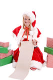 Santa helper with list smiling Stock Images