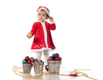 Santa helper little girl. Standing with ball Stock Images