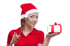 Santa helper looking into present box Stock Photos