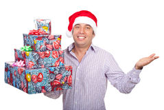 Santa helper man with gifts asking Stock Photography
