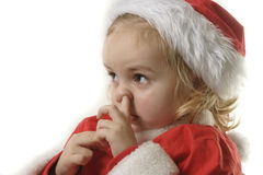 Santa helper picking his nose. Cute little elf on the wite background Stock Photo