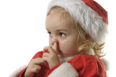 Santa helper picking his nose. Cute little elf on the withe background Stock Image