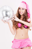 Santa helper in pink lingerie with disco ball Stock Photography