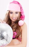 Santa helper in pink lingerie with disco ball Royalty Free Stock Images