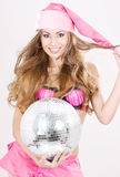 Santa helper in pink lingerie with disco ball Royalty Free Stock Photos