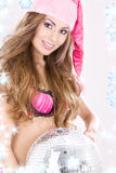 Santa helper in pink lingerie with disco ball Royalty Free Stock Photography