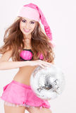 Santa helper in pink lingerie with disco ball Stock Image