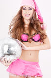 Santa helper in pink lingerie with disco ball Royalty Free Stock Image