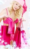 Santa helper with pink shopping bags Royalty Free Stock Photos