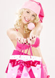 Santa helper with pink shopping bags Royalty Free Stock Image