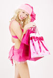 Santa helper with pink shopping bags Royalty Free Stock Photo