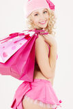 Santa helper with pink shopping bags Stock Image