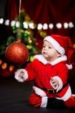 Santa helper playing with Christmas ball Royalty Free Stock Image
