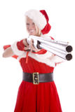 Santa helper pointing gun and smiling. Santa's helper showing you to be good while pointing a gun while smiling at the camera Royalty Free Stock Photos