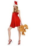 Santa helper with teddy bear Royalty Free Stock Photo
