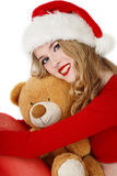 Santa helper with teddy bear Royalty Free Stock Photos