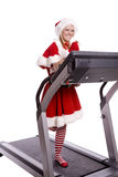 Santa helper on treadmill Stock Photos