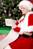 Santa helper by tree with list Stock Images