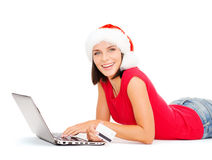Santa helper woman with laptop and credit card Stock Images