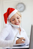 Santa helper working in office Stock Photo