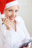 Santa helper working in office Royalty Free Stock Photo