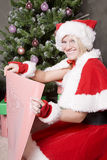 Santa helper wrapping gifts Royalty Free Stock Photography