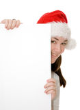 Santa hiding behind a card Royalty Free Stock Images