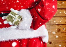 Santa hiding christmas gift behind his back Royalty Free Stock Photo