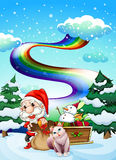 Santa and his cat in a snowy area with a rainbow Stock Photography