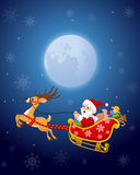 Santa in his Christmas sled being pulled by reindeer Stock Photo