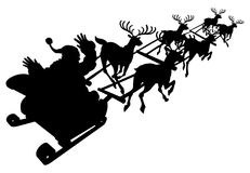 Santa in his Christmas sled or sleigh silhouette Royalty Free Stock Images