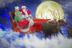 Santa and his elf on a sleigh  Royalty Free Stock Images