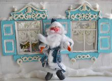 Santa and his home. Multicolored photo of plasticine Father Frost and New Year old house Stock Photo
