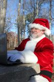 Santa With His Laptop Stock Images