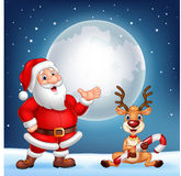Santa and his reindeer Rudolf Royalty Free Stock Image