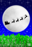 Santa and his reindeers riding against moon Stock Image