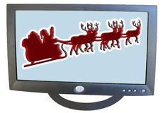 Santa on his sleigh. Using your television set Royalty Free Stock Photos