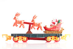 Santa on His Sleigh. With Reindeers Toy Train Caboose Stock Photo