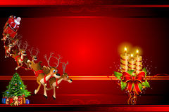 Santa with his sleigh coming towards big candles Stock Images