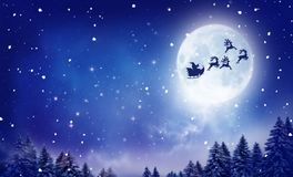 Santa and his sleigh flying over snowy landscape Royalty Free Stock Photos