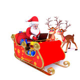 Santa is with his sleigh and laptop Royalty Free Stock Photography