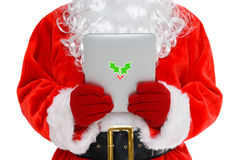 Santa on his tablet computer stock photo