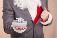 Santa Hold A Gift Box. Super Santa Opens A Tuxedo And Shows he Santa Clothes Royalty Free Stock Photo