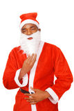 Santa holding beard Stock Images