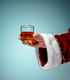 Santa Holding with a beer glass over blue Stock Image