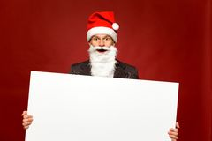 Santa holding blank poster Royalty Free Stock Photo