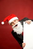 Santa holding blank poster Royalty Free Stock Images