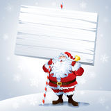 Santa holding a blank sign Royalty Free Stock Photos